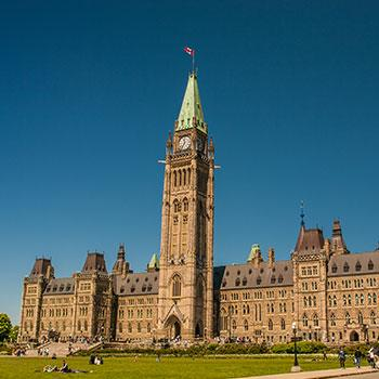 Picture of Ottawa's Parliamentary precinct with a clear blue sky behind.