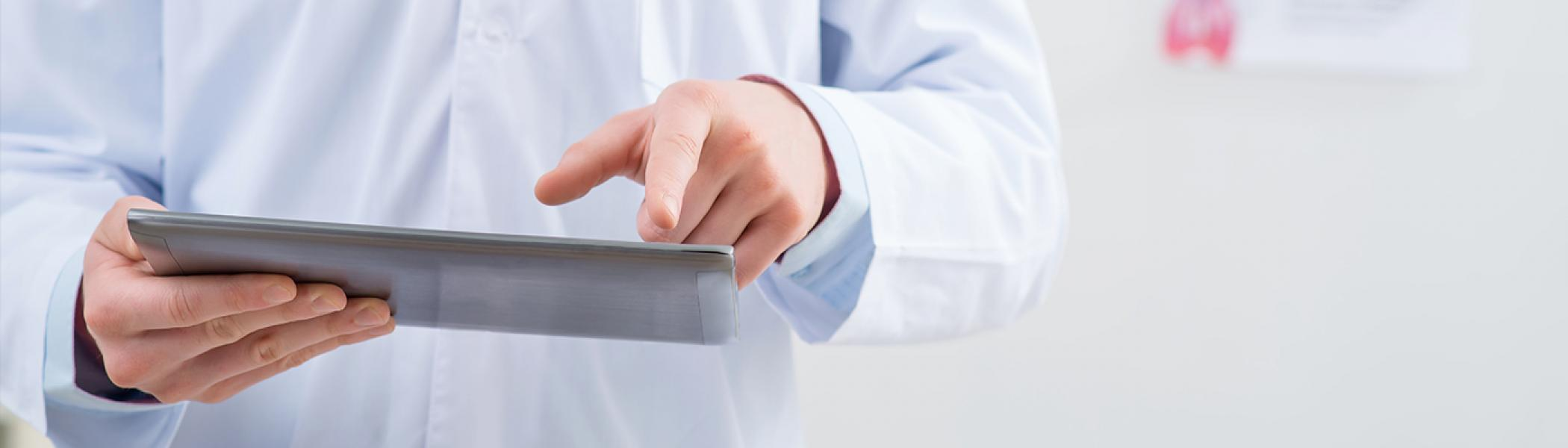 doctor is holding ipad in one hand