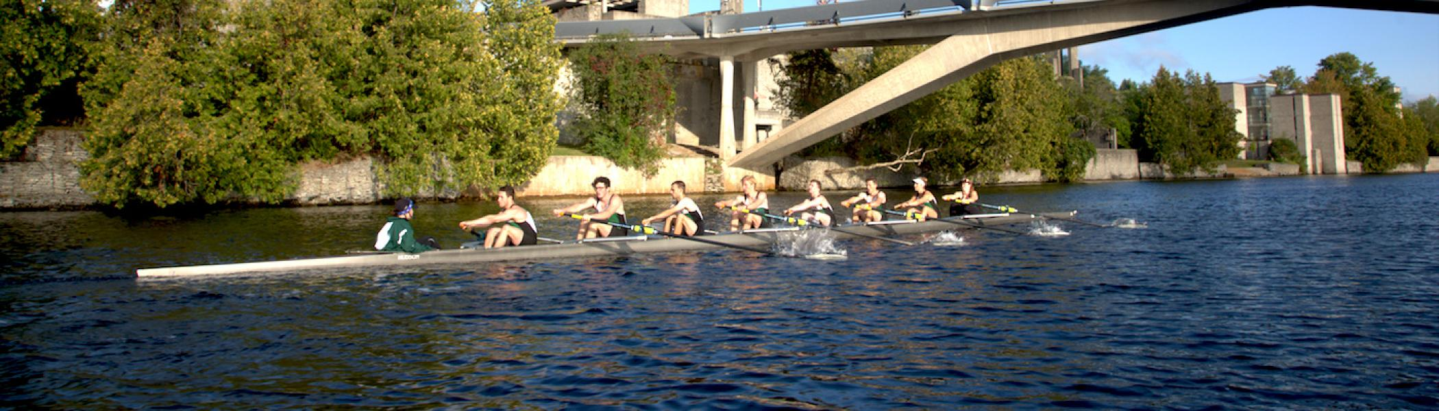 A group of people rowing on the Otonabee River