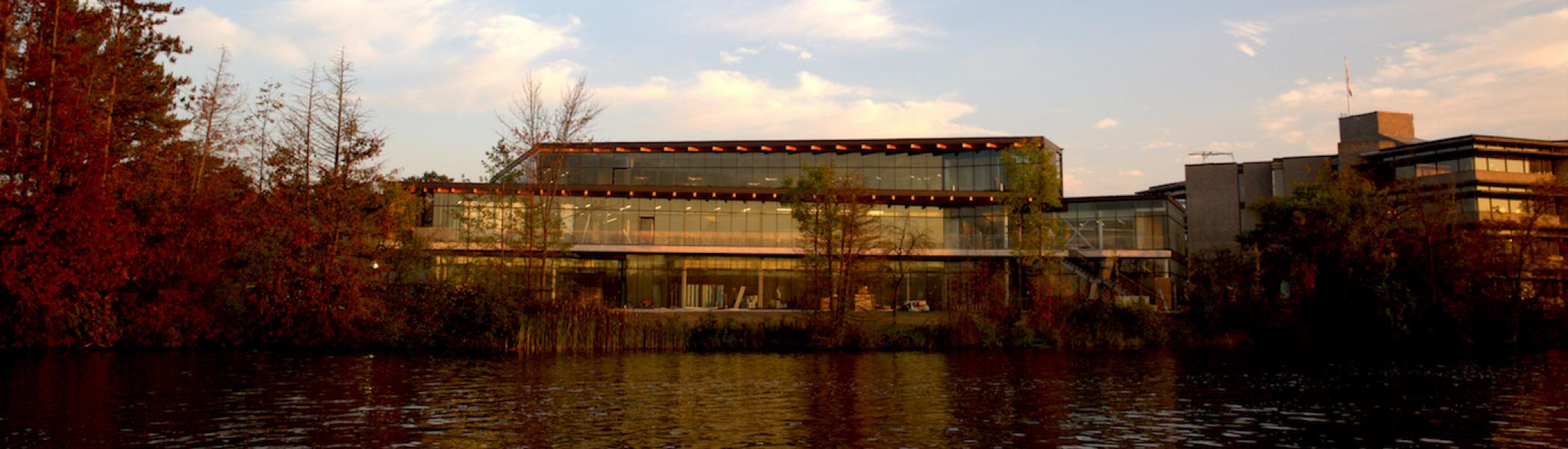 An exterior view of the student center with the river in the foreground