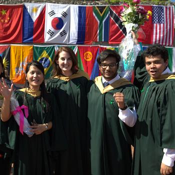 A group of students smiling at convocation