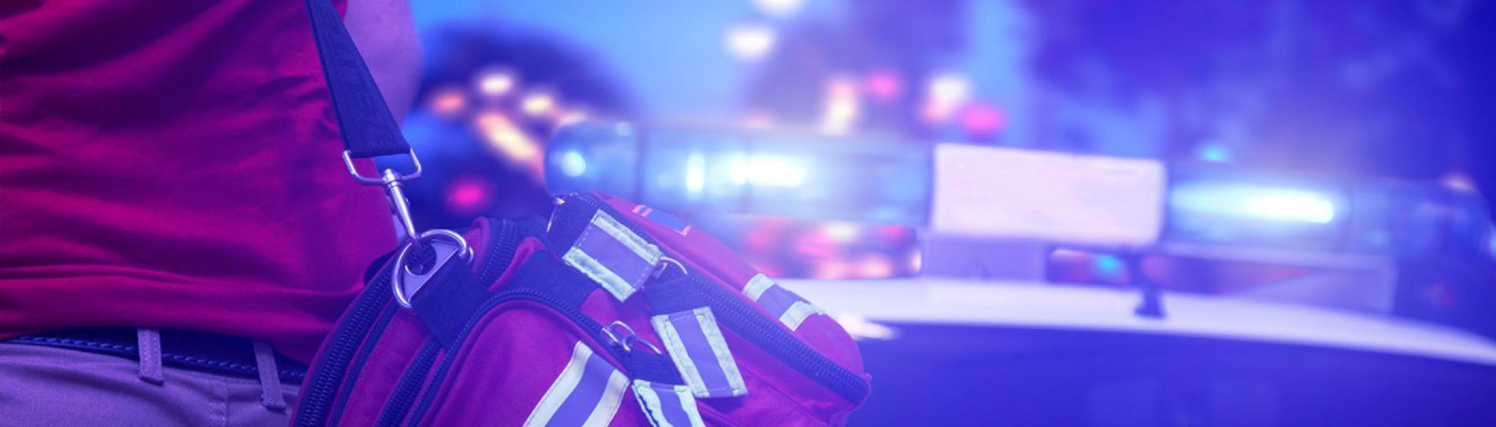 paramedic walking towards emergency vehicle