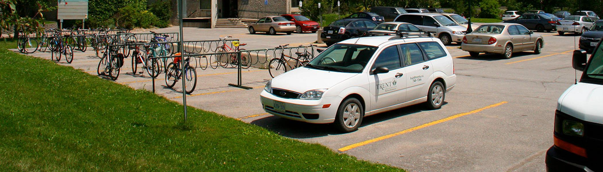 white trent vehicle parked in a lot beside bata library