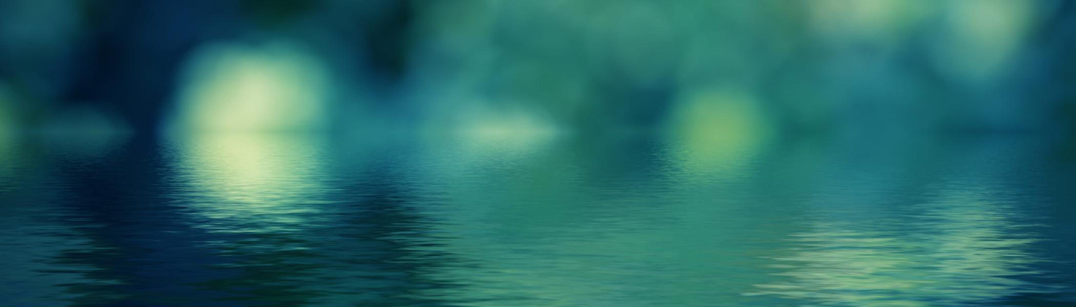Water with light reflecting in blue tones