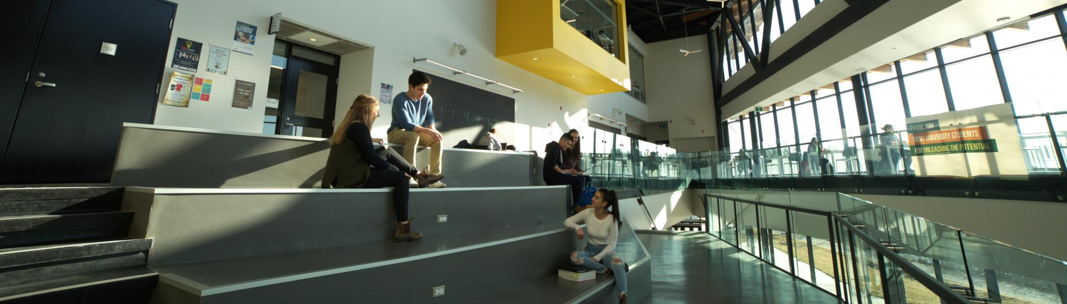 Students sitting talking and laughing in Student Centre