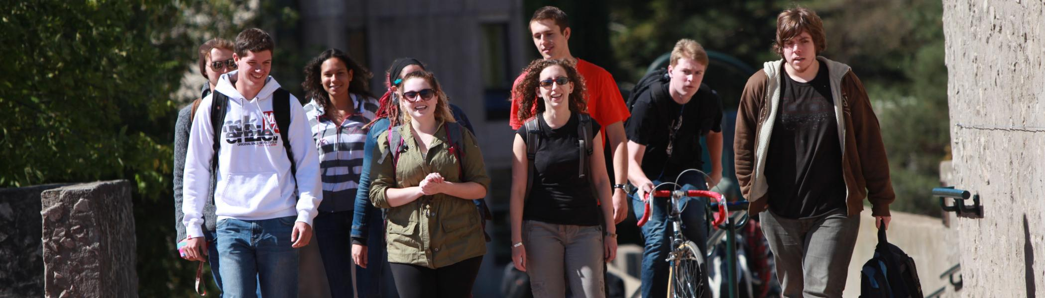 Group of people walking and smiling