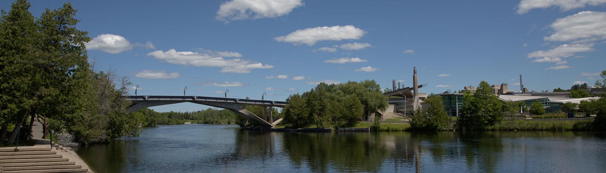 Shot of of the west bank and faryon bridge of Trent University