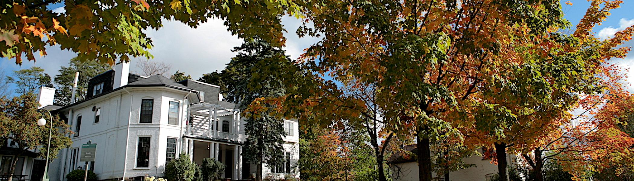 A view of Scott House at Traill College in the fall