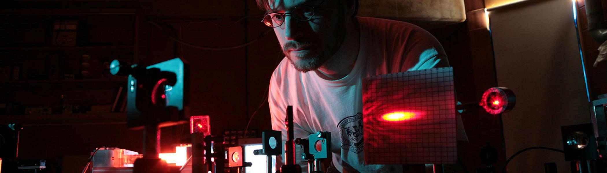 Student using lasers and other instruments in Trent's Centre for Materials Research