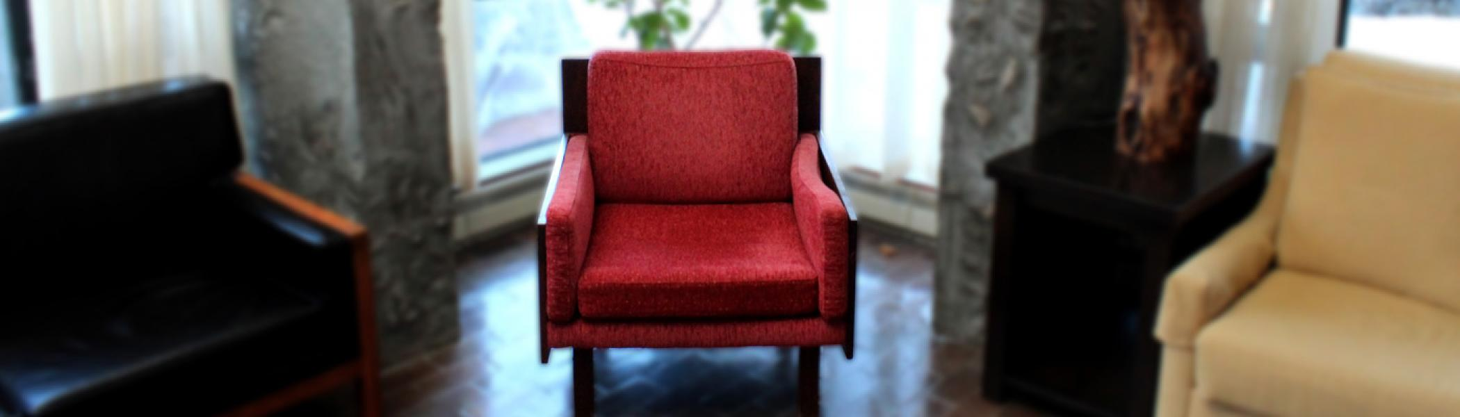 Image of red chair from alumni house