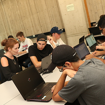 students working on their computers in a classroom