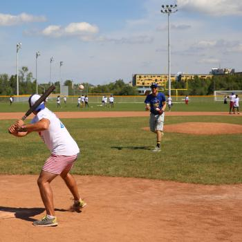 Men playing baseball on the field