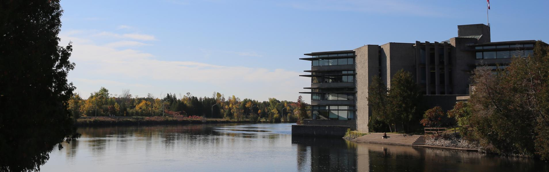 A view of bata library on the right with the Otonabee river on the left