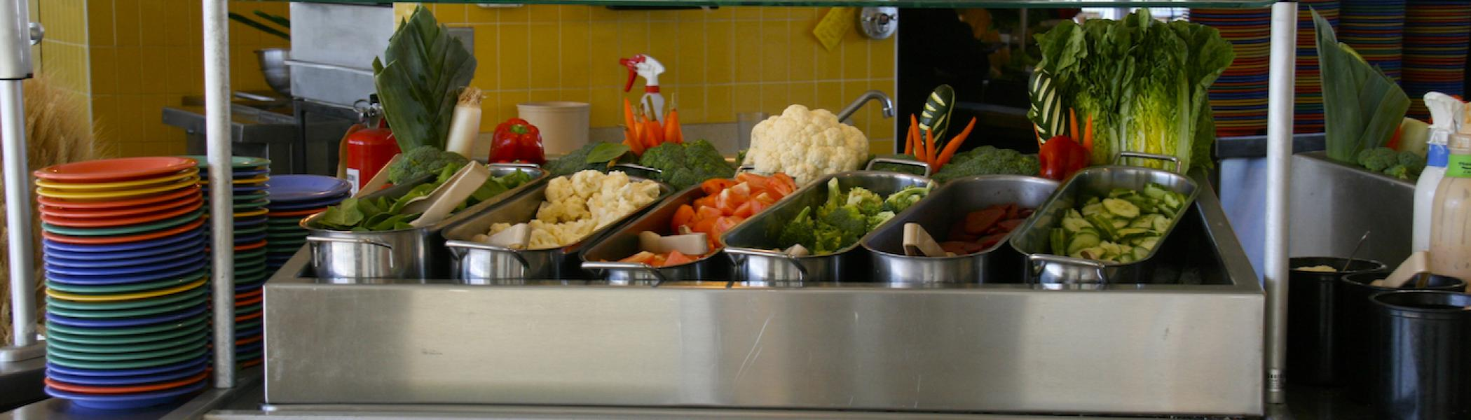 a tray full of food filled with vegetables