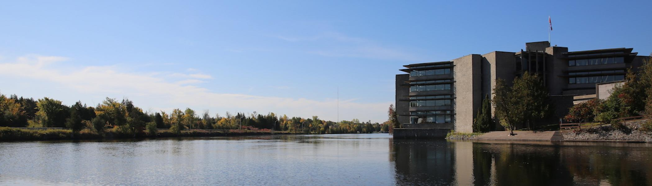 Bata Library in the summer with the Otonabee River on the left side