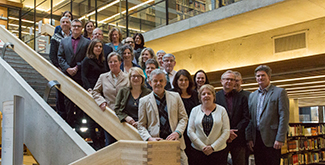 The Strategic Enrolment Management team standing in a group on the staircase of the Bata library on the first floor