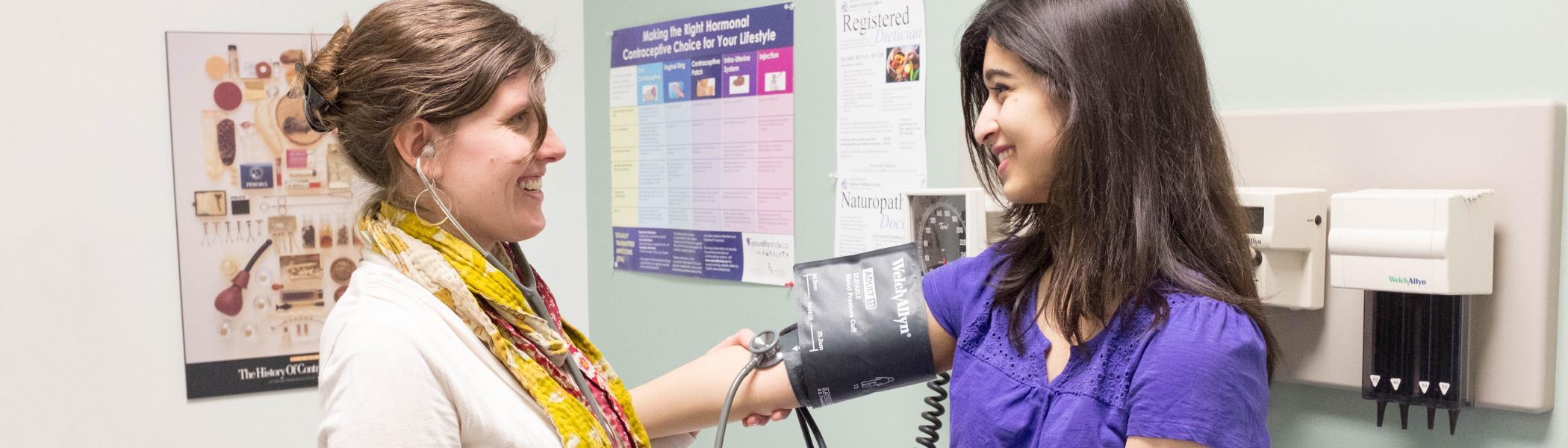 Student having blood pressure taken by nurse