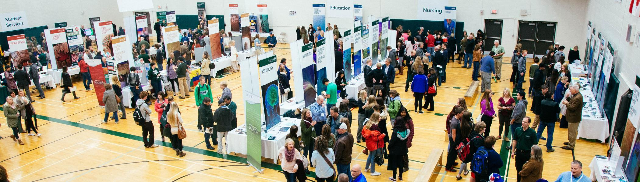 A busy student services fair during the open house at the Athletics Complex