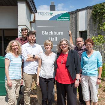SAS staff photo in front of Blackburn Hall